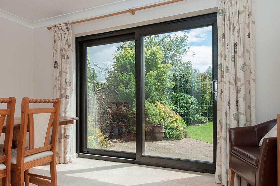 Gallery homeglaze quality windows doors porch for Quality patio doors