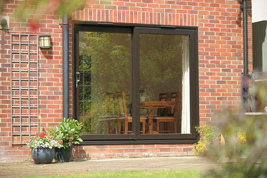 Upvc patio doors in essex south east homeglaze for Black upvc patio doors
