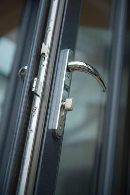 Grey uPVC french door lock closeup