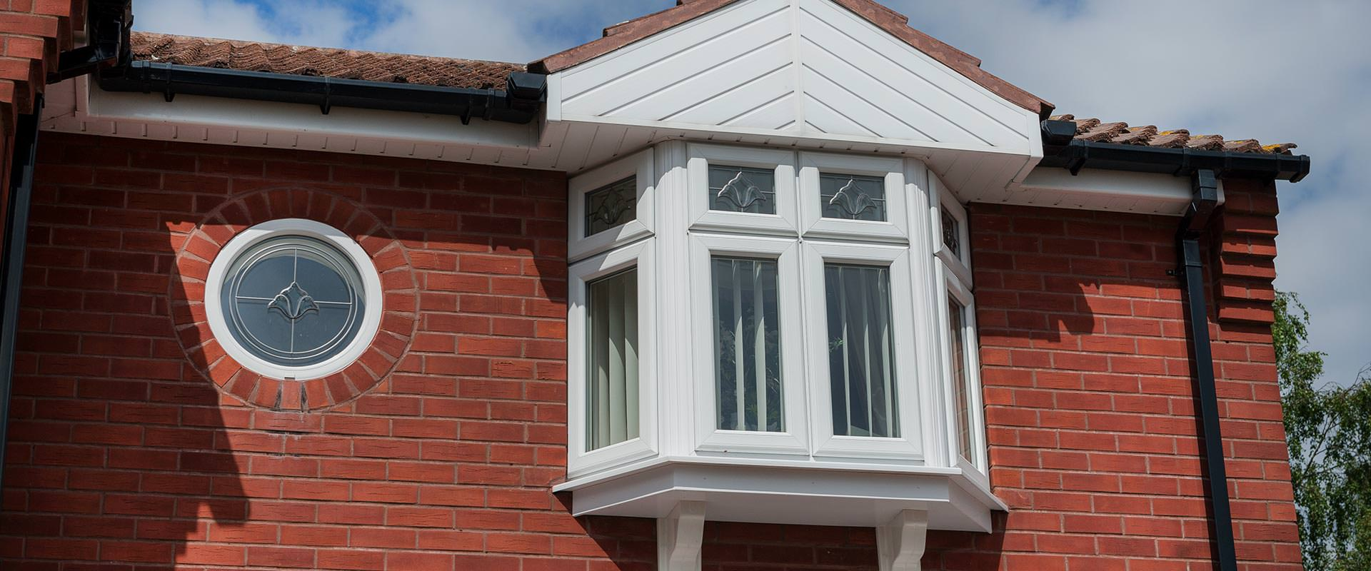 Windows homeglaze quality windows doors porch for Bay window installation