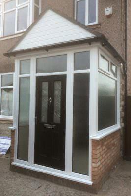 Black composite door and uPVC porch