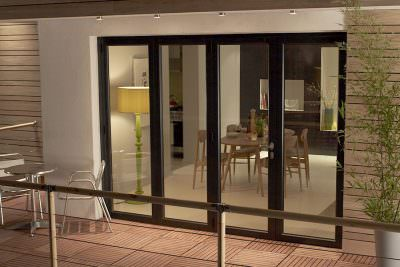 Black aluminium bifold door apartment exterior