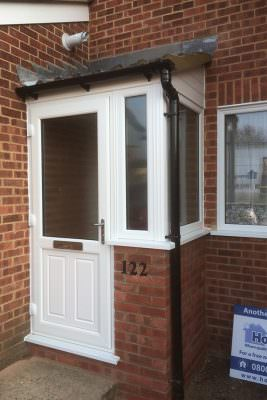White uPVC entrance door and porch