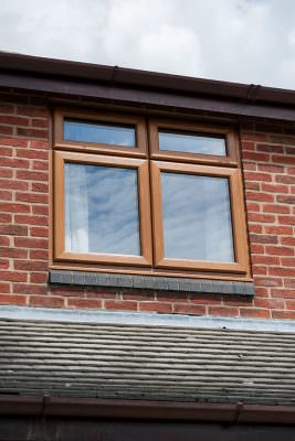 Oak effect casement window installation