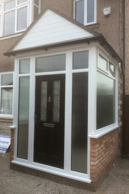 Black composite door and uPVC porch