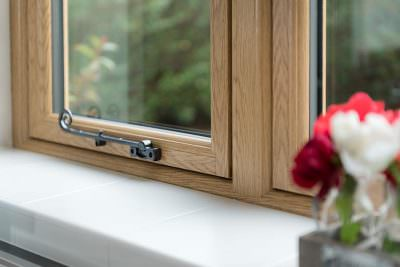 Oak effect flush sash window close up