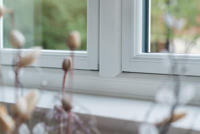 White uPVC flush sash window close up
